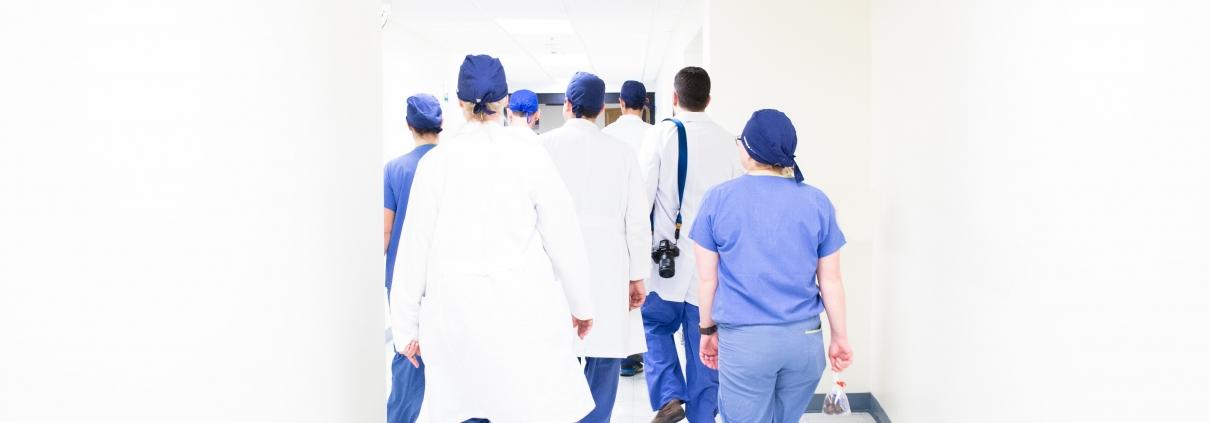 Healthcare staff walking down a corridor
